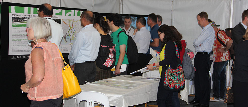 People inside the City Plan tent